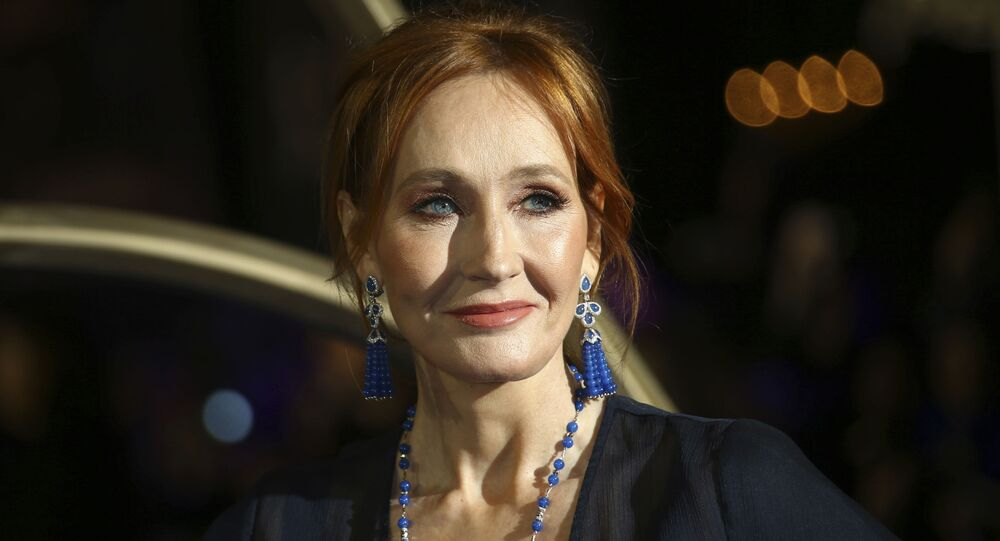 In this 13 November 2018 file photo, author J.K. Rowling poses for photographers upon her arrival at the premiere of the film 'Fantastic Beasts: The Crimes of Grindelwald', in London