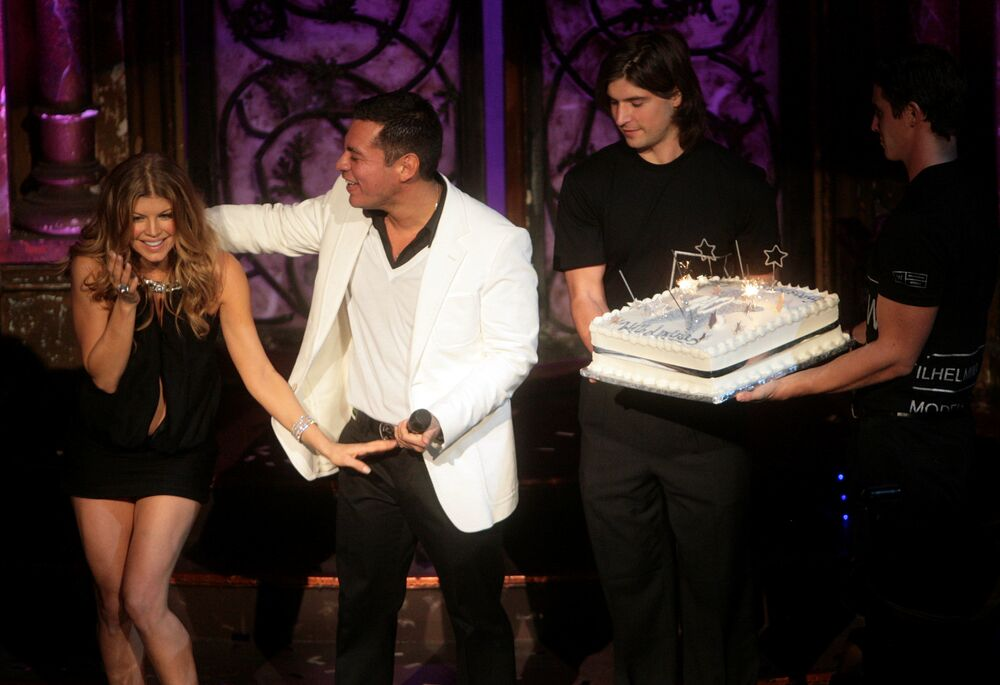 From left, American recording artist Fergie, and president of Wilhelmina Models Sean Patterson are presented with a cake celebrating Wilhelmina Models' 40th anniversary during the company's celebration at The Angel Orensanz Center on Thursday 29 November 2007 in Manhattan, New York, US.