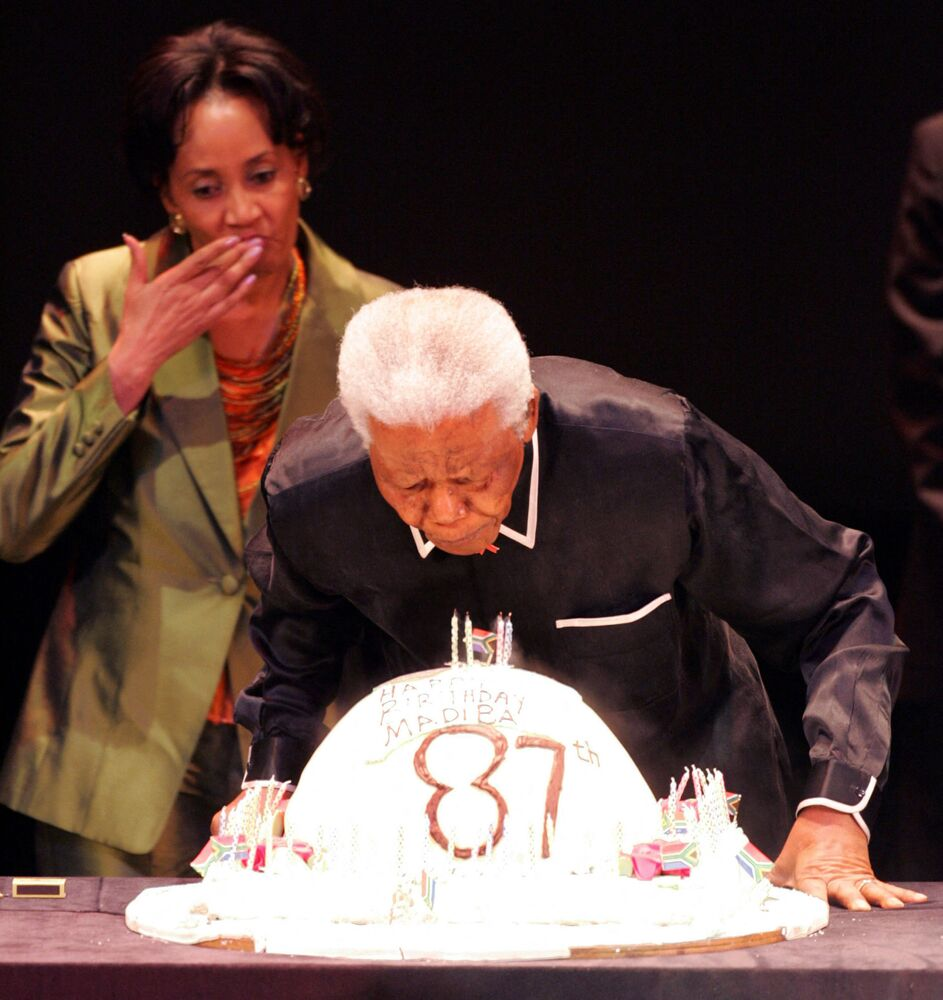Former South African President Nelson Mandela blows out candles for his 87th birthday during the third Nelson Mandela Annual Lecture on 19 July 2005 in Johannesburg, South Africa.