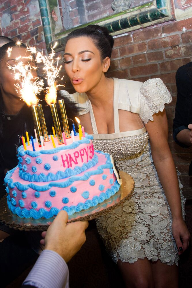 Kim Kardashian blows out the candles on a cake to celebrate her 30th Birthday at the 10th Anniversary of TAO restaurant in New York, on Sunday, 17 October 2010.