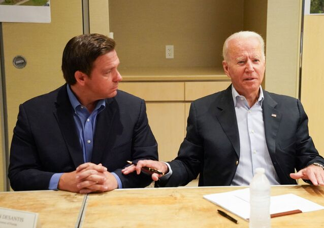 US President Joe Biden participates in a briefing about the building collapse in Surfside alongside Florida's Governor Ron DeSantis, in Miami, Florida, 1 July 2021