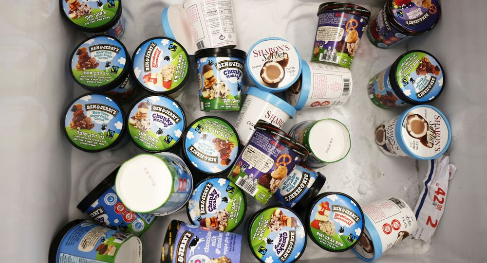 Tubs of Ben & Jerry's ice-creams are seen inside a refrigerator at a food store in the Jewish settlement of Efrat in the Israeli-occupied West Bank on 20 July 2021.