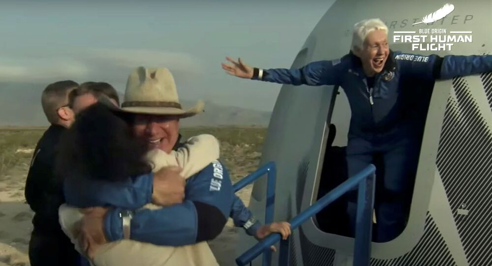 Billionaire businessman Jeff Bezos and pioneering female aviator Wally Funk emerge from their capsule after their flight aboard Blue Origin's New Shepard rocket on the world's first unpiloted suborbital flight near Van Horn, Texas, U.S., July 20, 2021 in a still image from video