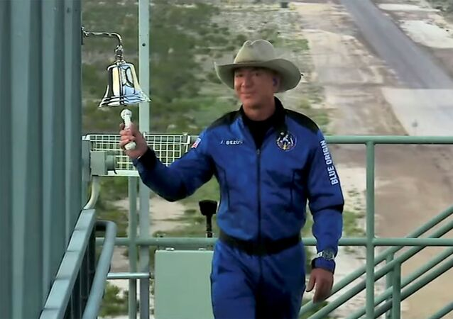 Billionaire Jeff Bezos, founder of ecommerce company Amazon.com Inc, rings a bell before boarding ahead of his scheduled flight aboard Blue Origin's New Shepard rocket near Van Horn, Texas, 20 July 2021 in a still image from a video