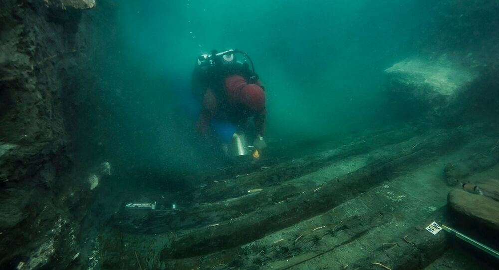 A diver examines the remains of an ancient military vessel discovered in the Mediterranean sunken city of Thonis-Heracleion off the coast of Alexandria, Egypt, in this handout image released on July 19, 2021.