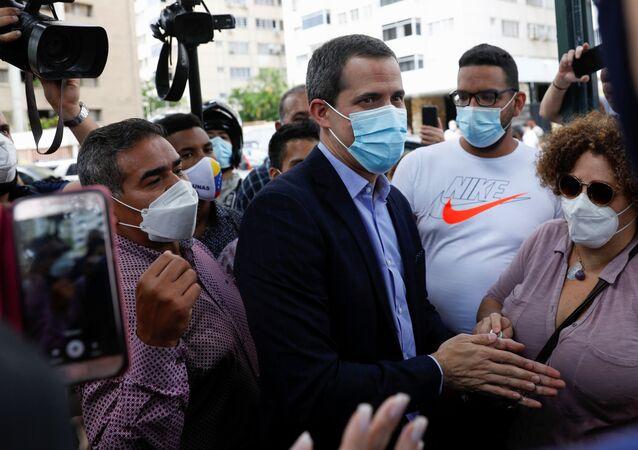 Venezuela's opposition figure Juan Guaido greets people, in Caracas, Venezuela on 12 July 2021.