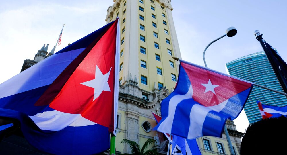 Emigres wave Cuban flags at the Freedom Tower in reaction to reports of protests in Cuba against its deteriorating economy, in Miami, Florida, U.S. July 17, 2021