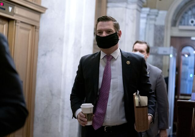 Rep. Eric Swalwell, D-Calif., arrives at the start of the fifth day of the second impeachment trial of former President Trump, Saturday, Feb. 13, 2021 at the Capitol in Washington.