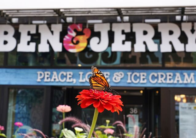 A Monarch butterfly lands on a flower outside the Ben & Jerry's Ice Cream shop, Tuesday, July 20, 2021, in Burlington, Vt.