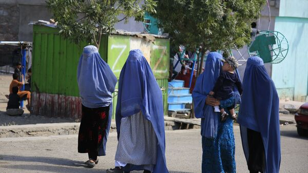 Afghan women walk on the road during the first day of Eid al-Fitr in Kabul, Afghanistan, Thursday, May 13, 2021 - Sputnik International