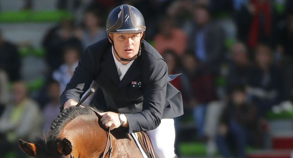 FILE - In this Sept. 3, 2014, file photo, Jamie Kermond of Australia, riding Quite Cassini competes during the second day of the team and individual qualifying show jumping event at the FEI World Equestrian Games in Caen, western France.