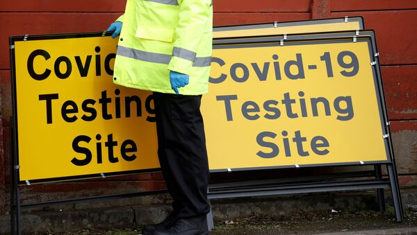 FILE PHOTO: Mobile testing centre during the outbreak of the coronavirus disease (COVID-19) in the Moston area of Manchester on 17 February 2021. - Sputnik International
