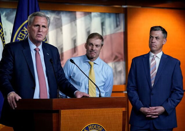 U.S. House Minority Leader Kevin McCarthy (R-CA) announces the withdrawal of his nominees to serve on the special committee probing the Jan. 6 attack on the Capitol, as two of the Republican nominees, Reps' Jim Jordan (R-OH) and Jim Banks (R-IN), standby during a news conference on Capitol Hill in Washington, U.S., July 21, 2021