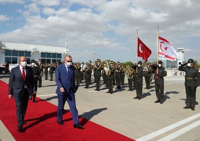 Turkish President Tayyip Erdogan reviews a guard of honour with Turkish Cypriot leader Ersin Tatar before he daparts from the Turkish Republic of Northern Cyprus, a breakway state recognized only by Turkey, in northern Nicosia, Cyprus July 20, 2021.