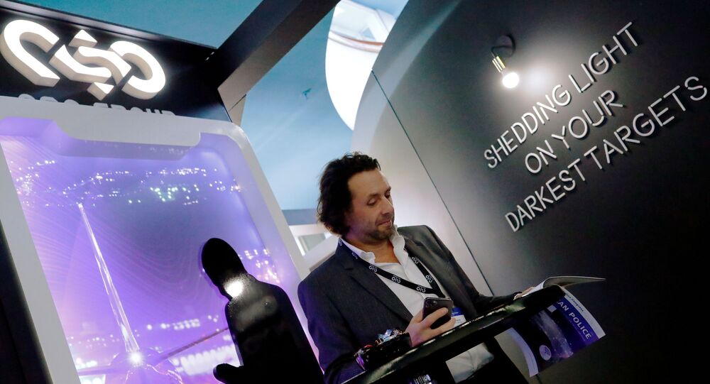 A man reads at a stand of the NSO Group Technologies, an Israeli technology firm known for its Pegasus spyware enabling the remote surveillance of smartphones, at the annual European Police Congress in Berlin, Germany, February 4, 2020.