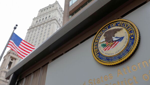 The seal of the United States Department of Justice is seen on the building exterior of the United States Attorney's Office of the Southern District of New York in Manhattan, New York City, U.S., August 17, 2020. - Sputnik International