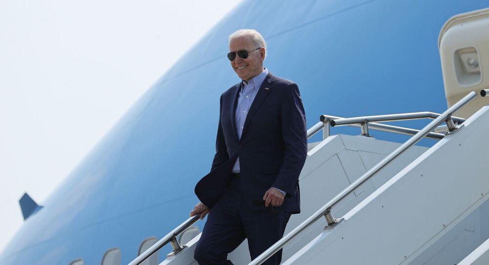 U.S. President Joe Biden disembarks from Air Force One as he arrives at Cincinnati/Northern Kentucky International Airport in Hebron, Kentucky, U.S. July 21, 2021.