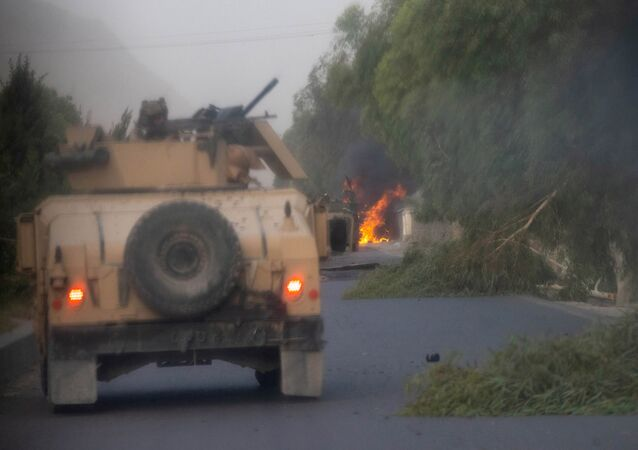 Humvees that belong to Afghan Special Forces are seen destroyed during heavy clashes with Taliban during the rescue mission of a police officer besieged at a check post, in Kandahar province, Afghanistan, July 13, 2021.
