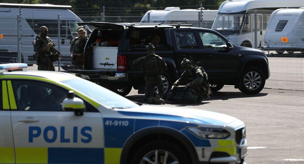 A police vehicle is seen at Hallby Prison, outside Eskilstuna, Sweden July 21, 2021.