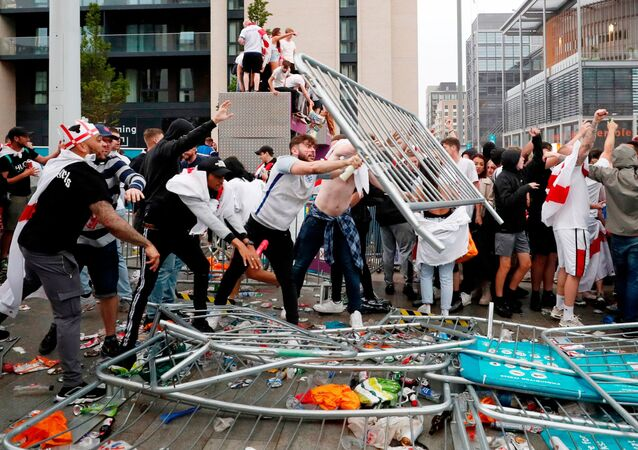Soccer Football - Euro 2020 - Final - Fans gather for Italy v England - Wembley Stadium, London, Britain - July 11, 2021 Picture taken July 11, 2021 England fans throw barriers outside Wembley Stadium during the match Action Images via Reuters/Lee Smith