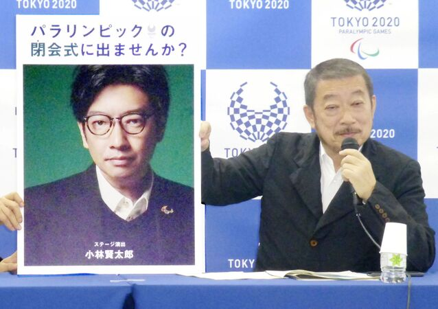 Hiroshi Sasaki, Tokyo 2020 Paralympic Games executive creative director, displays a portrait of Olympics opening ceremony show director Kentaro Kobayashi during a news conference in Tokyo, Japan, in this photo taken by Kyodo December 2019