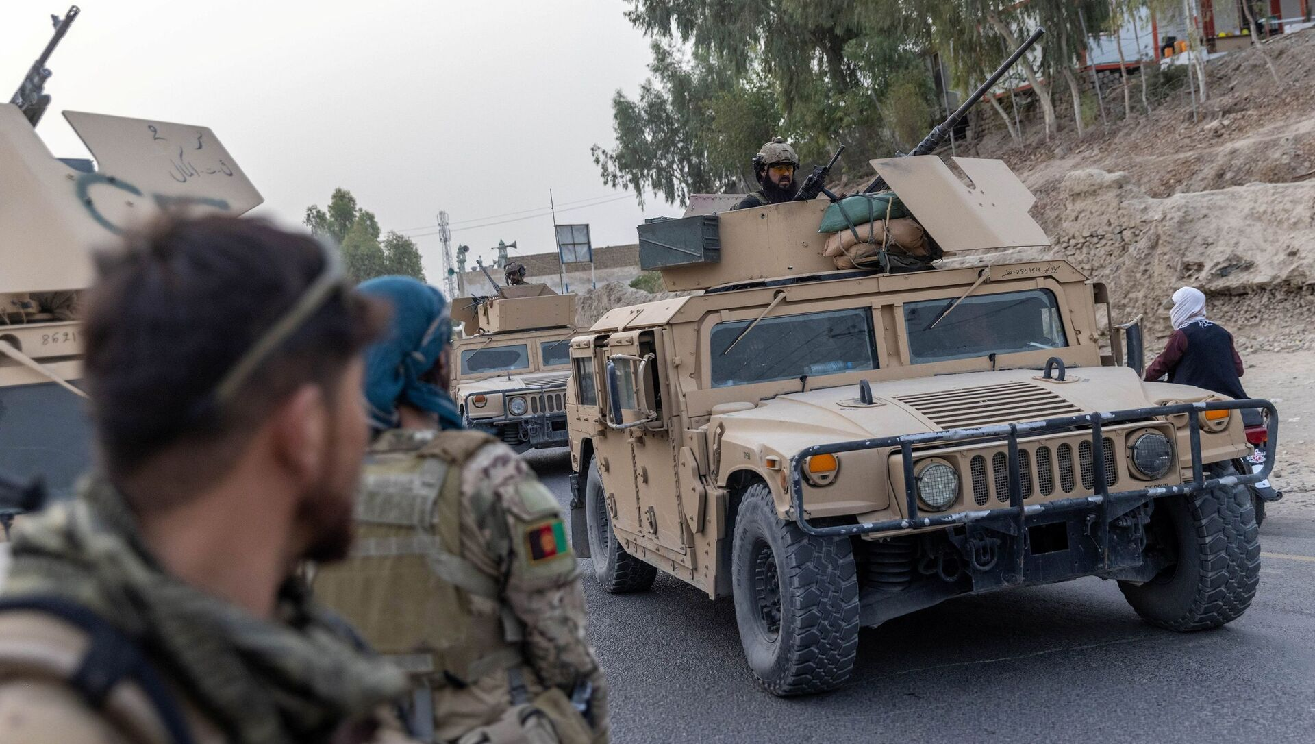 A convoy of Afghan Special Forces is seen during the rescue mission of a police officer besieged at a check post surrounded by Taliban, in Kandahar province, Afghanistan, July 13, 2021. REUTERS/Danish Siddiqui - Sputnik International, 1920, 03.08.2021