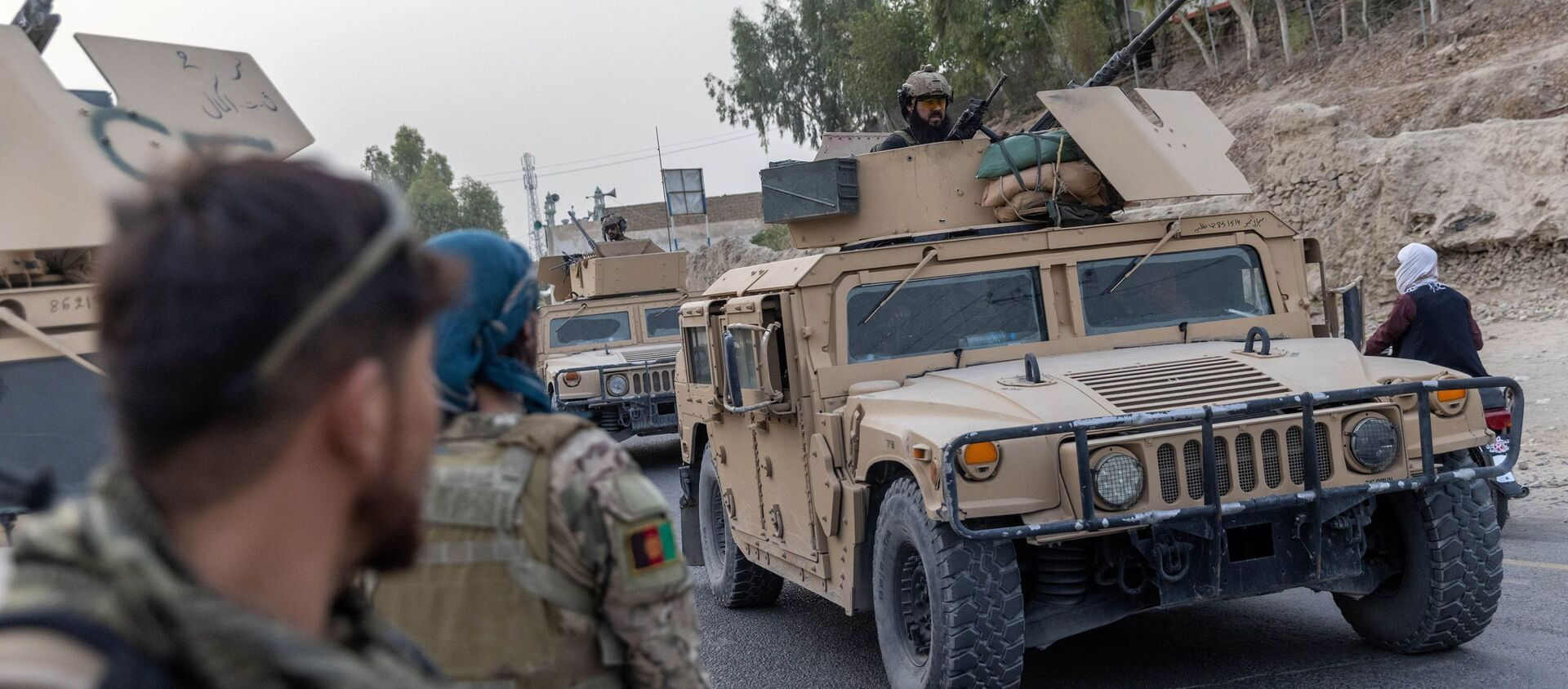 A convoy of Afghan Special Forces is seen during the rescue mission of a police officer besieged at a check post surrounded by Taliban, in Kandahar province, Afghanistan, 13 July 2021. REUTERS/Danish Siddiqui - Sputnik International, 1920, 22.07.2021