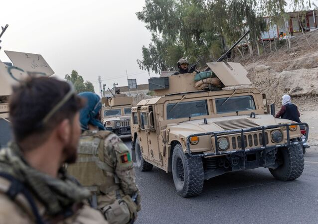 A convoy of Afghan Special Forces is seen during the rescue mission of a police officer besieged at a check post surrounded by Taliban, in Kandahar province, Afghanistan, 13 July 2021. REUTERS/Danish Siddiqui