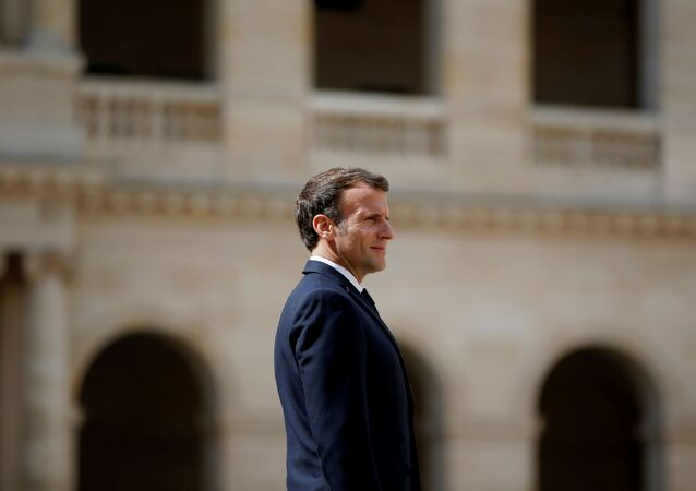 French President Emmanuel Macron attends a prise d'armes military ceremony at the Invalides in Paris, France, July 8, 2021. REUTERS/Sarah Meyssonnier/Pool