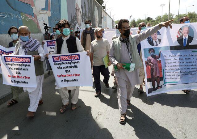 Former Afghan interpreters, who worked with U.S. troops in Afghanistan, demonstrate in front of the U.S. embassy in Kabul June 25, 2021.