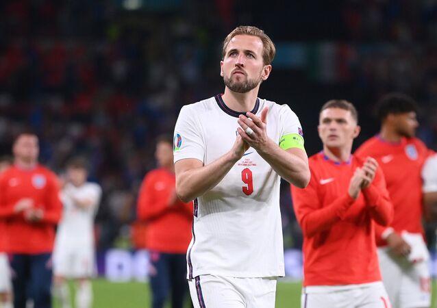 England's Harry Kane applauds fans after the match