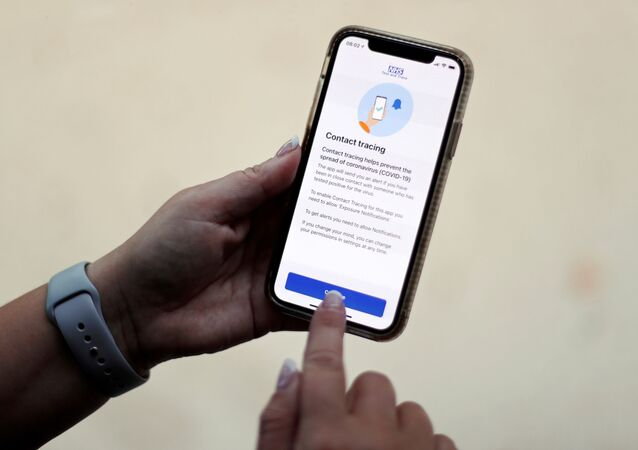 FILE PHOTO: The coronavirus disease (COVID-19) contact tracing smartphone app of Britain's National Health Service (NHS) is displayed on an iPhone in this illustration photograph taken in Keele, Britain, September 24, 2020.
