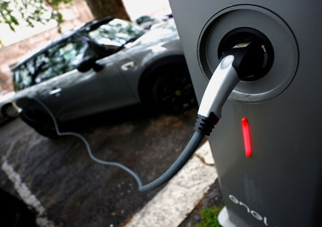 An electric car is seen plugged in at a charging point for electric vehicles (File)