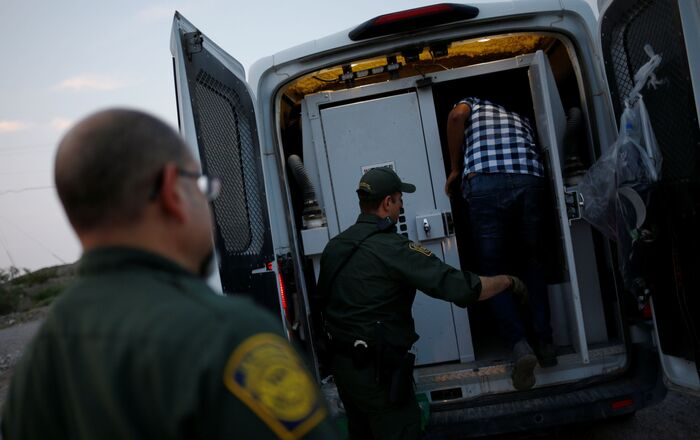 A migrant from Central America is detained by U.S. Border Patrol agents after crossing into the United States from Mexico, in Sunland Park, New Mexico, U.S., July 22, 2021