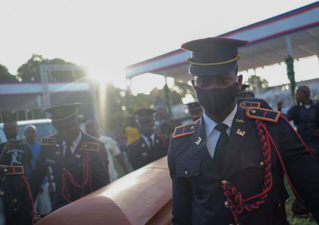 Pallbearers in military attire carry the coffin holding the body of late Haitian President Jovenel Moise after he was shot dead at his home in Port-au-Prince earlier this month, in Cap-Haitien, July 23, 2021. REUTERS/Ricardo Arduengo