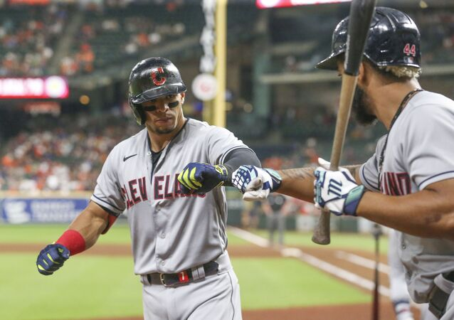 Cleveland Indians designated hitter Bobby Bradley (44)  congratulates second baseman Cesar Hernandez (7) on his home run against the Houston Astros in the seventh inning at Minute Maid Park.