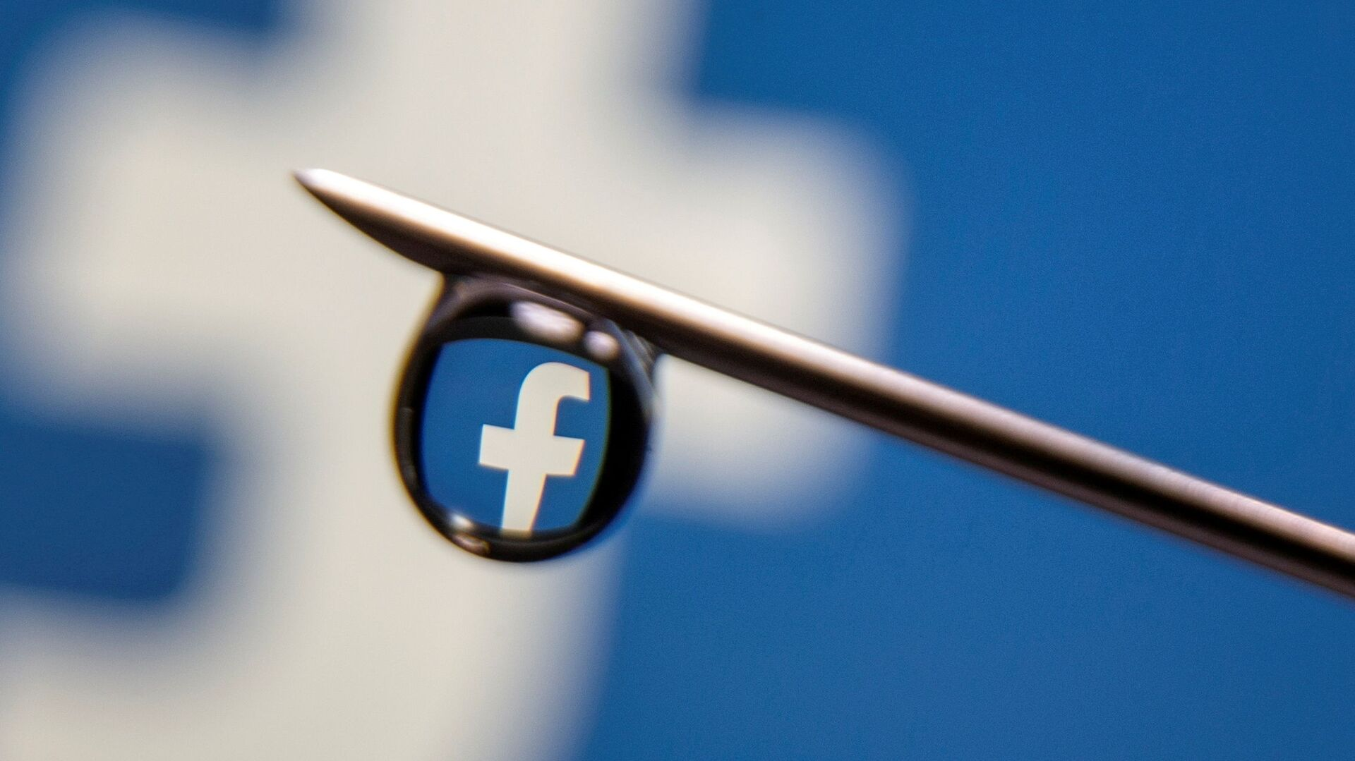 Facebook logo is reflected in a drop on a syringe needle in this illustration photo taken 16 March 2021 - Sputnik International, 1920, 23.07.2021