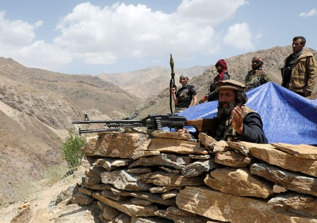 Armed men who are against the Taliban uprising stand at their check post, at the Ghorband District, Parwan Province, Afghanistan, 29 June 2021.