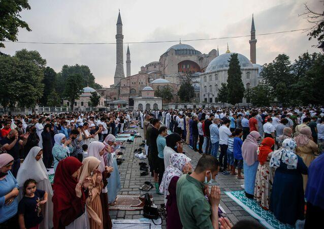 Worshippers attend prayers marking the Muslim festival of sacrifice Eid al-Adha at Hagia Sophia Grand Mosque in Istanbul, Turkey, July 20, 2021.