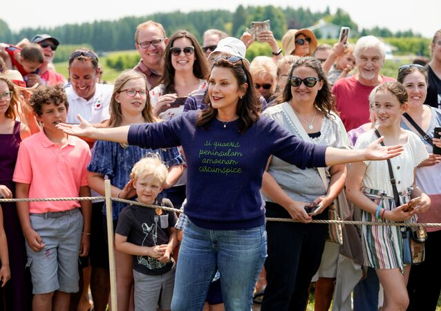 Michigan's Governor Gretchen Whitmer gestures in front of supporters after touring King Orchards farm in Central Lake, Michigan, 3 July 2021.