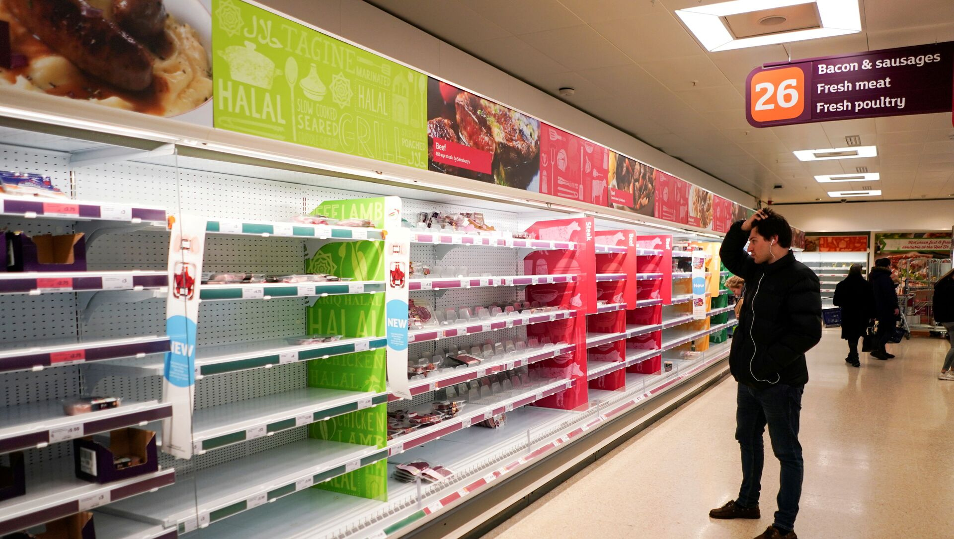 FILE PHOTO: A man stands next to shelves empty of fresh meat in a supermarket, as the number of worldwide coronavirus cases continues to grow,  in London, Britain, March 15, 2020 - Sputnik International, 1920, 24.07.2021