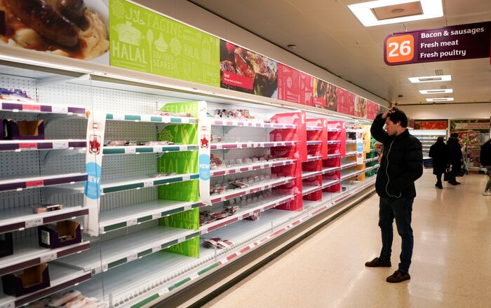 FILE PHOTO: A man stands next to shelves empty of fresh meat in a supermarket, as the number of worldwide coronavirus cases continues to grow,  in London, Britain, March 15, 2020