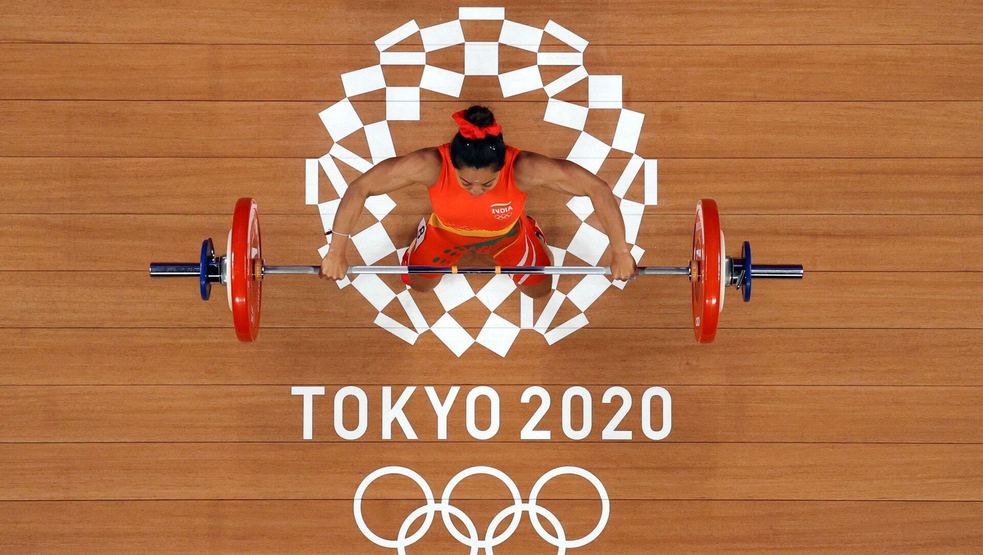 Tokyo 2020 Olympics - Weightlifting - Women's 49kg - Group A - Tokyo International Forum, Tokyo, Japan - July 24, 2021.  Mirabai Chanu Saikhom of India in action. Pool via REUTERS/Chris Graythen - Sputnik International, 1920, 24.07.2021