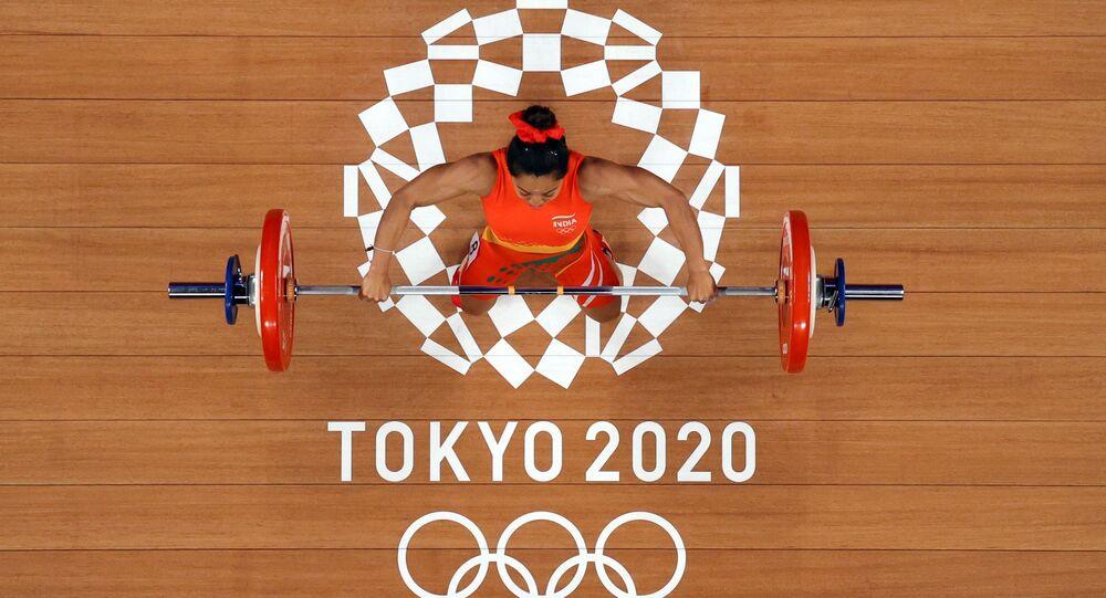 Tokyo 2020 Olympics - Weightlifting - Women's 49kg - Group A - Tokyo International Forum, Tokyo, Japan - July 24, 2021. Mirabai Chanu Saikhom of India in action. Pool via REUTERS/Chris Graythen