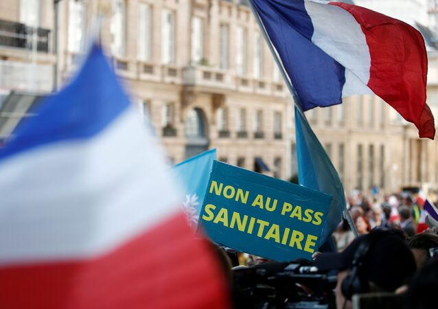 A placard reads No to the health pass during a demonstration called by the Popular Republican Union (UPR) against the new coronavirus safety measures including a compulsory health pass in front of the French Senate in Paris, France 22 July 2021.
