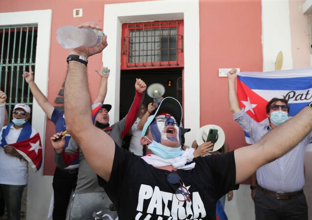 Cuban residents gather to protest against the Cuban government after recent demonstrations erupted in Cuba amid widespread shortages of basic goods, demands for political rights and the coronavirus disease (COVID-19) outbreak, in Santo Domingo, Dominican Republic July 18, 2021.