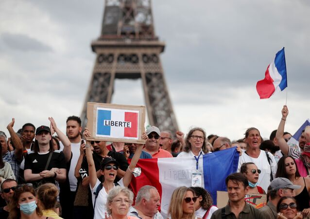 Protesters attend a demonstration called by the French nationalist party Les Patriotes (The Patriots) against France's restrictions to fight the coronavirus disease (COVID-19) outbreak, on the Droits de l'Homme (human rights) esplanade at the Trocadero Square in Paris, France, July 24, 2021.