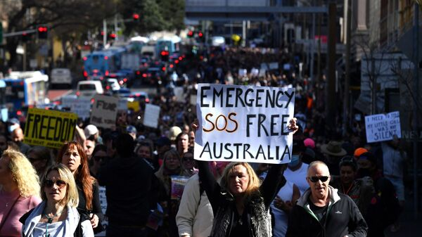 Protesters march through the city centre during an anti-lockdown rally as an outbreak of the coronavirus disease (COVID-19) affects Sydney, Australia, July 24, 2021. - Sputnik International