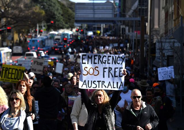 Protesters march through the city centre during an anti-lockdown rally as an outbreak of the coronavirus disease (COVID-19) affects Sydney, Australia, July 24, 2021.