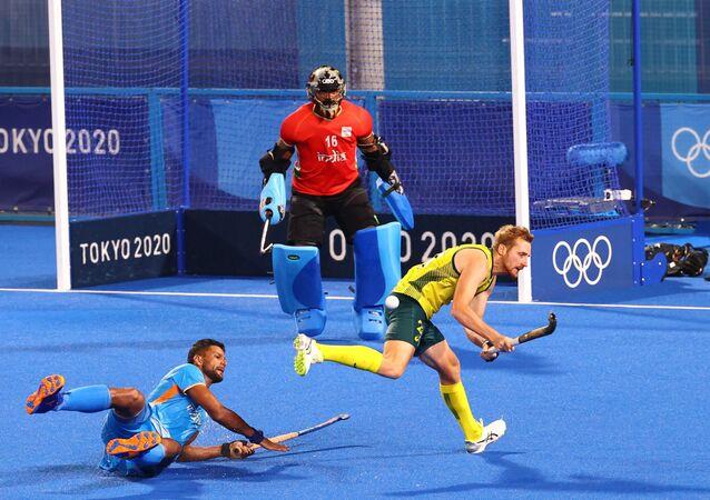 Tokyo 2020 Olympics - Hockey - Men's Pool A - India v Australia - Oi Hockey Stadium, Tokyo, Japan - July 25, 2021. Rupinder Pal Singh of India in action with Daniel Beale of Australia. REUTERS/Bernadett Szabo